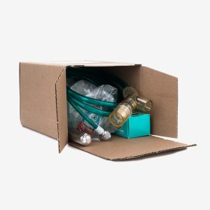 Tipped cardboard box containing green tubing with yellow, white and grey connectors, small green box, red bottle, silver tool