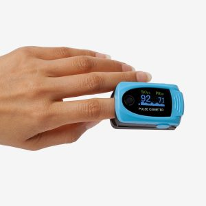Hand using a MD300 C63 pulse oximeter on white background